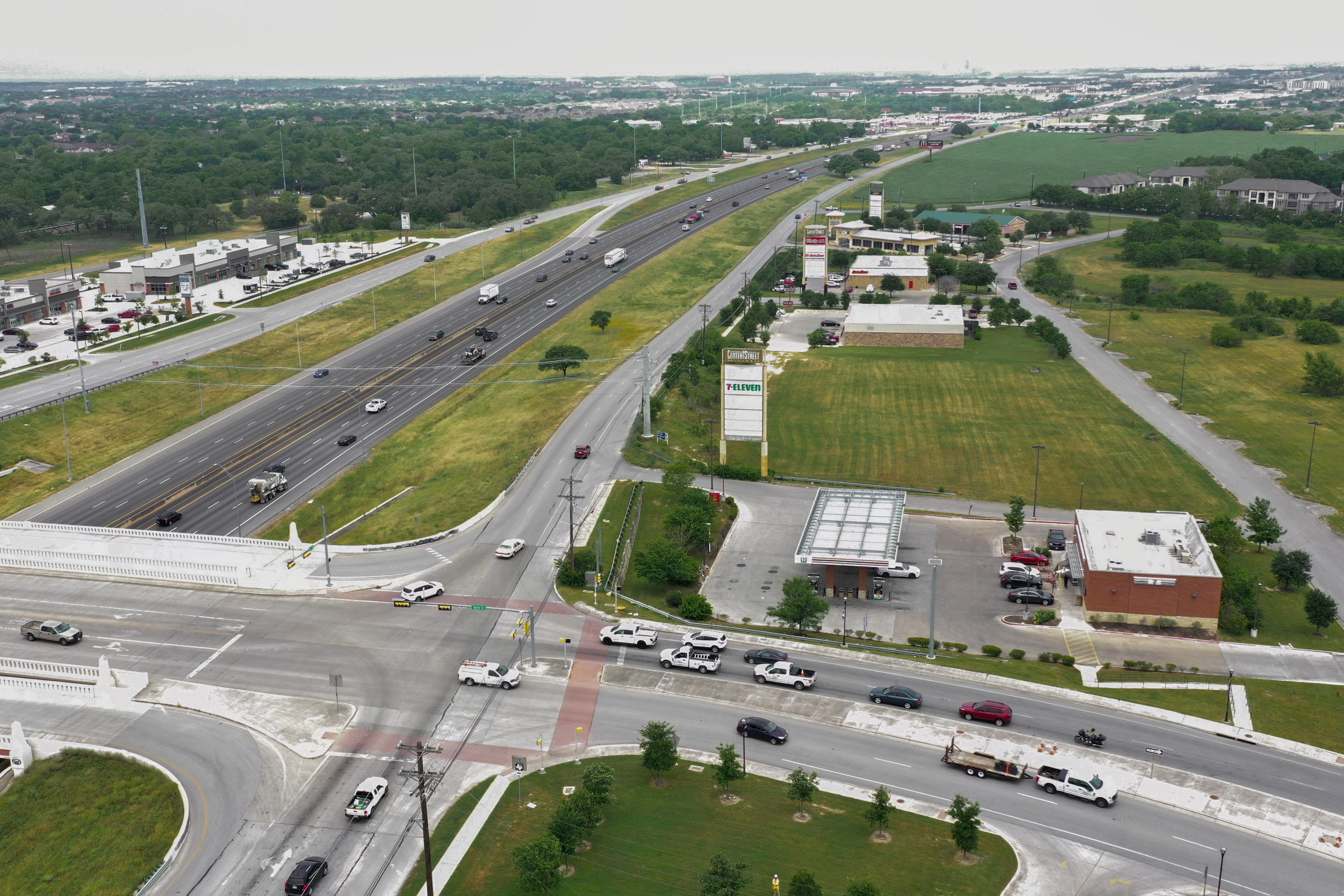 Northbound I-35 frontage road at RM 150 before construction starts