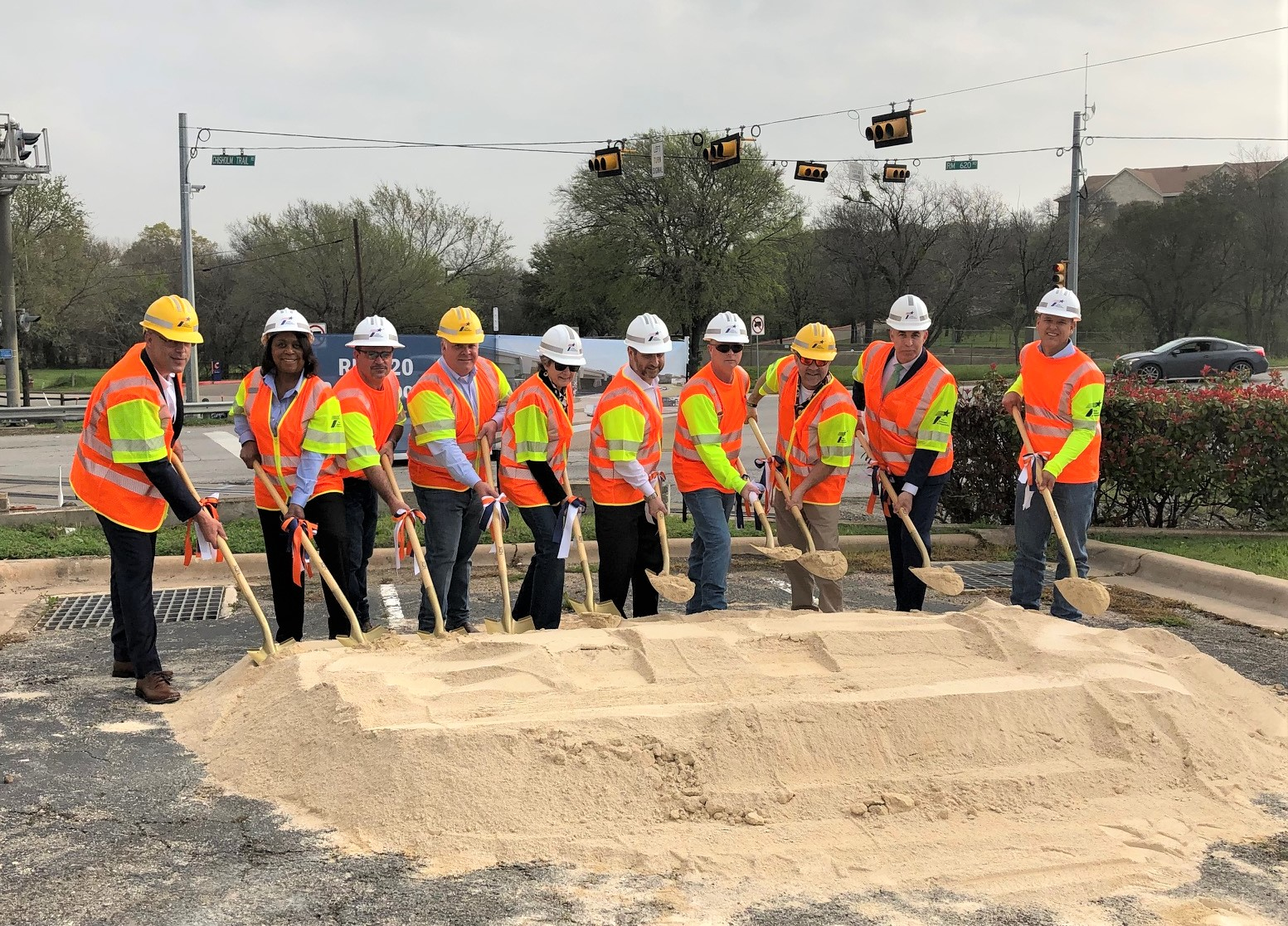 TxDOT officials join Williamson County Commissioner Terry Cook, Round Rock Mayor Craig Morgan, August Alvarado with Congressman John Carter's office and others to turn dirt for the new RM 620 Roundabout project.